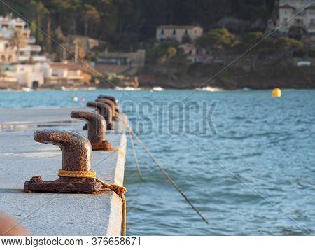 Mooring Pin For Medium Size Boat. Rusty Bent Mooring Bollard In A Port.