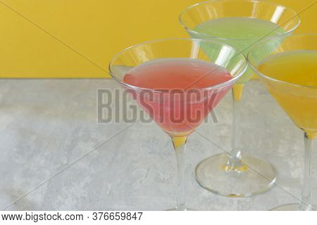 Several Glasses Of Various Delicious Fruit Non-alcoholic Cocktails On A Bright Background. Health Dr