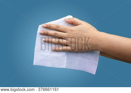 Female Using Wet Antibacterial Personal Hygiene Wipes To Clean Hands