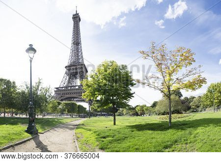 Paris Eiffel Tower With Park Pathway In Paris, France. Eiffel Tower Is One Of The Most Iconic Landma