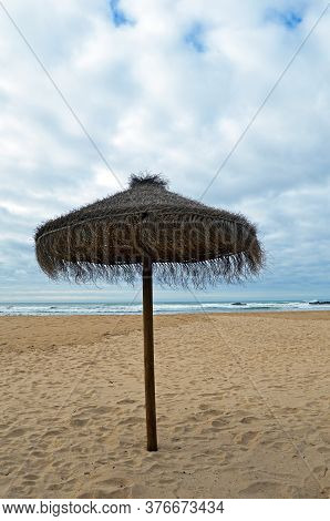 Sunshade On The Beach In Odeceixe On The Atlantic Coast Of Portugal