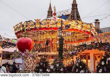 Moscow, Russia- December 16, 2019: Christmas Carousel At The Fair Near Gum Shop On Red Square In Mos