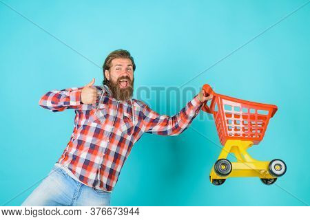 Bearded Man With Shopping Cart Shows Thumb Up. Supermarket. Shopping. Sale. Discount. Black Friday.