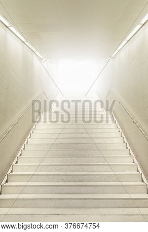 Stairway Going Up Into A Bright Light. Underground Staircase. Modern Architecture In The Basement Of