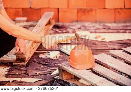 Under Protection. Strong He Met. Builder Hand Put Hammer On Hard Hat. Professional Repairman. Life S