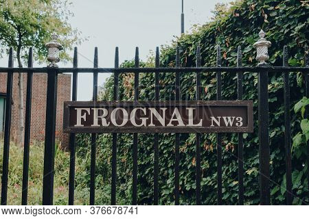 London, Uk - July 02, 2020: Street Name Sign On A Metal Fence On Frognal, Hampstead, An Affluent Res