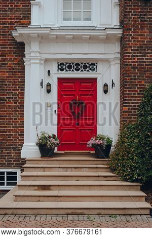 London, Uk - July 02, 2020: Red Door With A Heart Decor On A Facade Of Traditional English House In