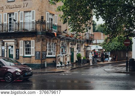 London, Uk - July 02, 2020: People Queuing Under The Rain For La Creperie De Hampstead In Hampstead,