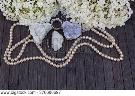 On A Wooden Background Lies Three Semiprecious Stones Of Aquamarine, Prenite, Celestine. Nearby Are