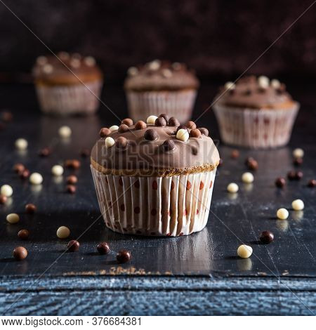 Chocolate Glazed Simple Cupcakes On A Dark Presentation