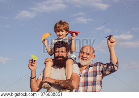 Leisure Activity. Grandfather Playtime. Happy Smiling Boy On Shoulder Dad Looking At Camera. Generat
