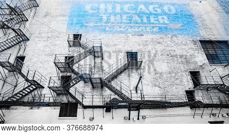Chicago United States - August 27 2015; Old Exterior Faded Brick Wall And Blue Sign Surrounded By Fi