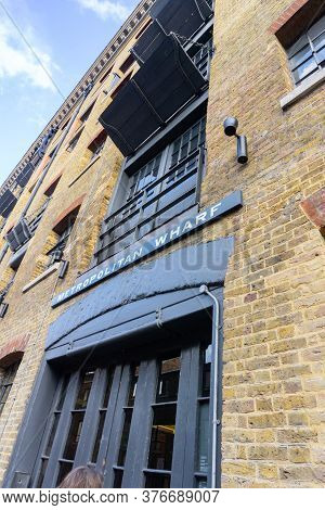 Wapping, London, United Kingdom - August 24 2015; Historic Building Metropolitan Wharf On Side Of Th