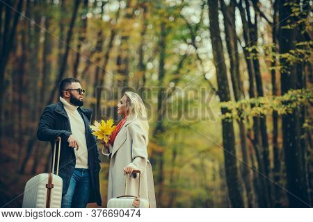 Beautiful Couple Over Autumn Background. Young Couple Outdoors At The Park On Beautiful Autumn Day.