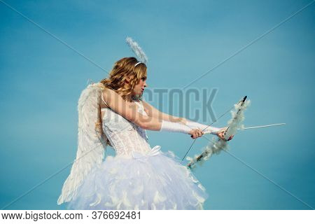 Angel Children Girl With White Wings. Innocent Girl With Angel Wings Standing With Bow And Arrow Aga