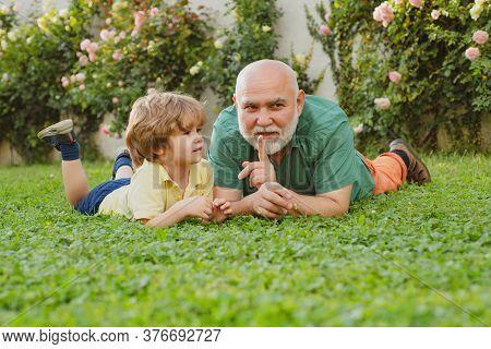 Child With Grandfather Dreams In Summer In Nature. Grandpa Retiree. Grandpa Retiree. Senior Man With