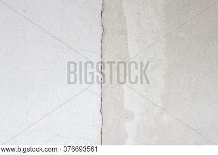 Textures Of Old Cement Wall With Uneven Cracks And Joints For Background.