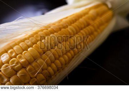 A Closeup View Of Fresh Raw Maize Corn & Leaves