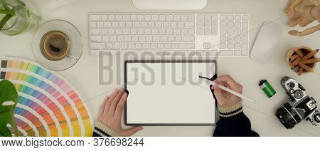 Female Designer Working With Mock Up Tablet, Computer, Camera And Supplies On White Desk