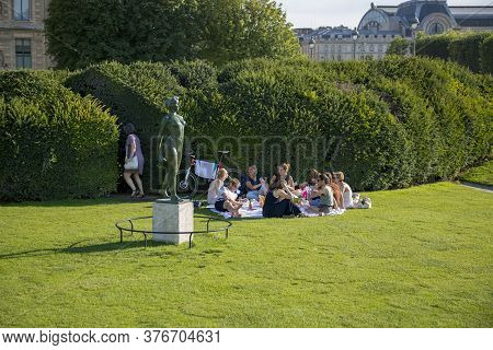 Paris, France - July 04, 2018: Young People Resting On The Grass In The Tuileries Garden In Paris