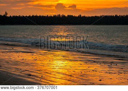 Tropical Sunset On The Beach.