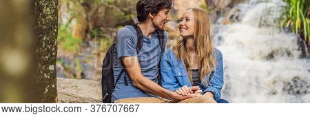 Couple Of Tourists With A Backpack On The Background Of A Waterfall Banner, Long Format
