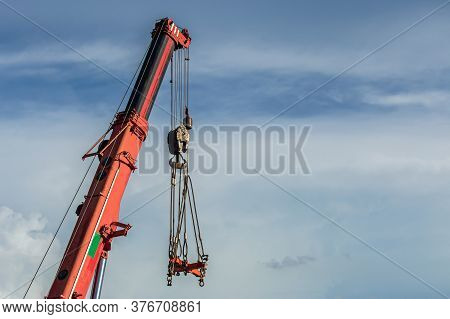 High-rise Crane For Construction On Sky Background. Tower Cranes For Rent With Installation At Const