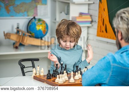 Concentrated Boy Developing Chess Strategy, Playing Board Game. Thinking Kid. Chess, Success And Win