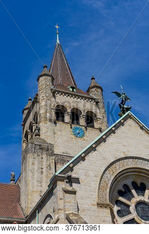 A Close Up View Of The Church Steeple Of The Pauluskirche Church In Basel