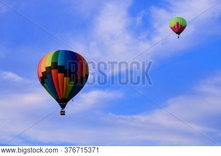 Two Multicolored Balloons In Rise High Into The Sky, Hot Air Balloons, Air Transport, Travel By Air,
