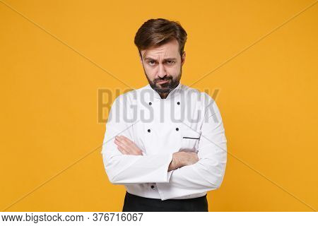 Perplexed Confused Young Bearded Male Chef Cook Or Baker Man In White Uniform Shirt Posing Isolated