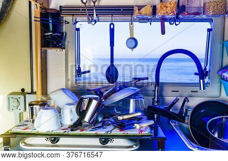 Caravan Rv Inside, Dishwashing In Kitchen. Many Clean Dishes On Dish Drying Mat After Washing Up. Lo