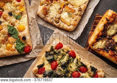 Top View On Different Italian Focaccia Bread With Tomatoes Spinach And Olives, Horizontal