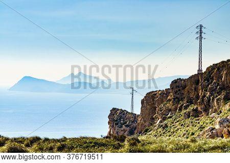 Electricity Transmission Pylons, Power Lines High Voltage Towers On Spanish Coastline. Almeria Coast