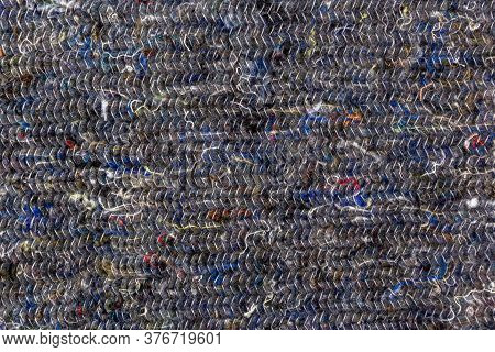 The Background For The Design Of The Floor Cleaning Fabric. Dark Fabric With Multi-coloured Threads