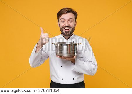 Funny Young Bearded Male Chef Cook Or Baker Man In White Uniform Shirt Posing Isolated On Yellow Bac