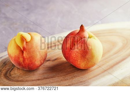 An Ugly Fruit Or Vegetable. A Very Ugly Peach Mutant On A Wooden Stand. Ugly Fruits Are Not In High