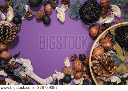Elegant Dried Botanical Mixture And Bamboo Bowl On A Purple Background Creating A Frame Shape With C