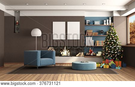 Living Room With Blue Armchair,fireplace And Christmas Tree With Gift - 3d Rendering