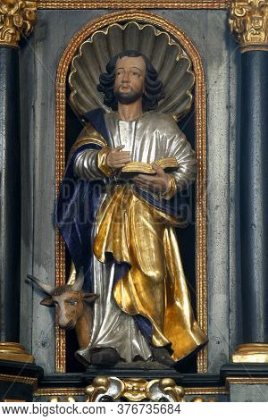 ZAGREB, CROATIA - MAY 16, 2013: Saint Luke the Evangelist, statue on the pulpit in the Church of Saint Catherine of Alexandria in Zagreb, Croatia