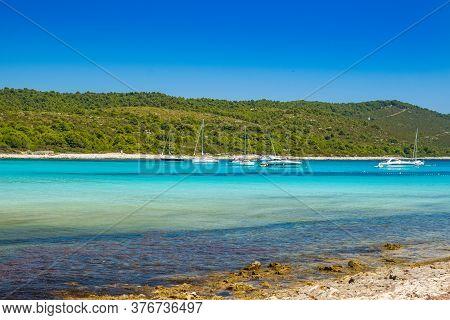 Azure Turquoise Lagoon On Sakarun Beach On Dugi Otok Island, Croatia, Yachts Anchored In Clear Sea W