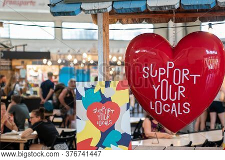 Basel, Bl / Switzerland - 8 July 2020: Civic Pride And Support Sign In The Market Hall In Downtown B