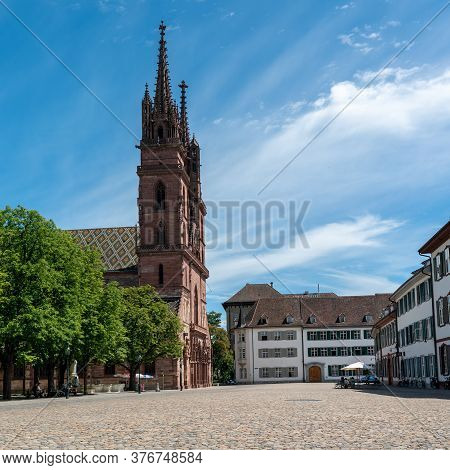 Basel, Bl / Switzerland - 8 July 2020: The Historic Minster In Basel And The Minster Square