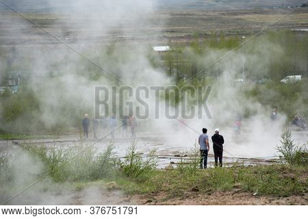Strokkur Geyser, Iceland - May 20, 2019: Tourists Visiting And Waiting For The Eruption Of Strokkur