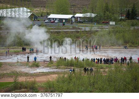 Tourists Visiting Strokkur Geyser In Iceland
