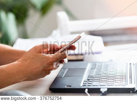 Woman Looking At Cell Phone. Woman Looking At Cell Phone Message. Woman Watching Cell Phone While Wo