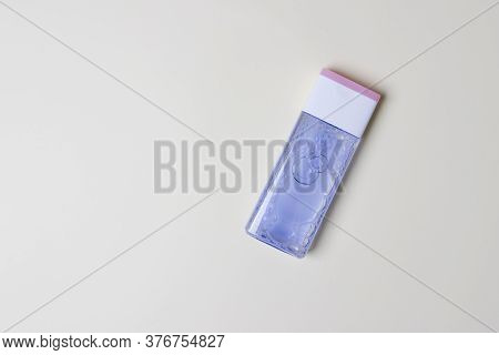 Bottle With Tonic For Health Care On Yellow Colored Paper Background With Copy Space.