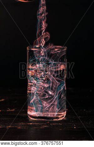 A Glass Of Water With Polluted Smoke