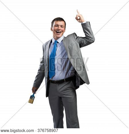 Emotional And Creative Businessman Painter Finger Pointing Upwards. Portrait Of Happy Handsome Man I
