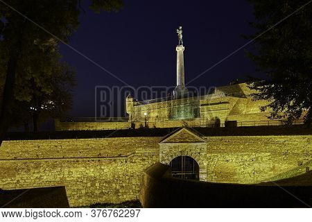 Night View Of The Belgrade Fortress (kalemegdan) With Victor Monument, Symbol Of Belgrade, Dedicated